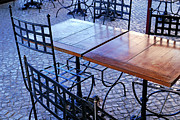 Town Square Prints - Wrought iron chairs and wooden tables in cafe Print by Sami Sarkis