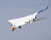 Low Wing Photo Posters - X-48b Blended Wing Body In Flight Poster by Stocktrek Images