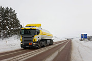 Snow Covered Street Framed Prints - Yellow And White Fuel Tanker Truck Framed Print by Jaak Nilson