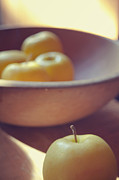 Wooden Bowl Photos - Yellow apples by Toni Hopper