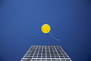 Yellow Balloon Floating Past Single Skyscraper Print by Thomas Jackson