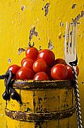 Bucket Posters - Yellow bucket with tomatoes Poster by Garry Gay