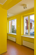 Grade School Prints - Yellow Hallway of a School Print by Jaak Nilson