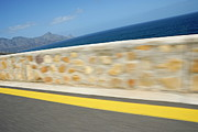 Yellow Line Photo Prints - Yellow line on a coastal road by sea Print by Sami Sarkis