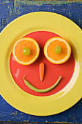 Carrots Posters - Yellow plate with food face Poster by Garry Gay