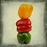 Balancing Posters - Yellow red and green bell pepper Poster by Bernard Jaubert