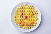 Vitamine Photos - Yellow Smiley Face On A White Plate by George Shanshin