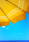 Blue Sailboat Posters - Yellow umbrella with sea and sailboat Poster by Silvia Ganora