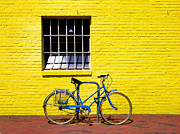 Yellow Building Prints - Yellow Wall and Blue Bicycle Print by Steven Ainsworth