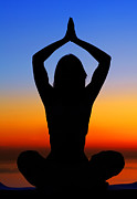 Meditation Photo Posters - Yoga woman over sunset Poster by Anna Omelchenko