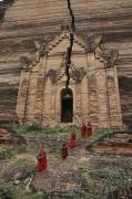 Buddhist Clothing Prints - Young Buddhist Monks Near A Ruined Print by Paul Chesley