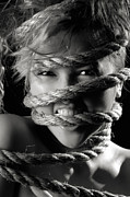 Angry Face Prints - Young Expressive Woman Tied in Ropes Print by Oleksiy Maksymenko