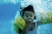 Head Piece Posters - Young Girl Diving In A Swimming Pool Underwater Poster by Sami Sarkis