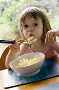 Supper Bowl Prints - Young Girl Eating Pasta Print by Ian Boddy