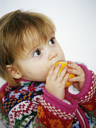 Tasting Photos - Young Girl With Satsuma by Ian Boddy