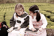 Children Playing Portrait Prints - Young girls doodling Print by Gaspar Avila