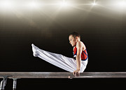 Parallel World Framed Prints - Young Male Gymnast Performing On Parallel Bars Framed Print by Robert Decelis Ltd