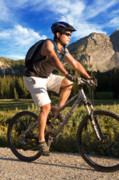 Mountain Biking Posters - Young Man Mountain Biking Poster by Utah Images