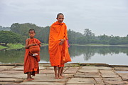 Angkor Prints - Young monks portrait on their way to Angkor Wat Print by Sami Sarkis
