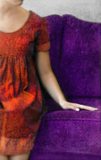 Purple Couch Posters - Young Woman in Red on Purple Couch Poster by Jill Battaglia