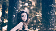 Brown Hair Prints - Young woman in the forest Print by Gabriela Insuratelu