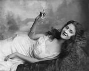 1900s Portraits Photos - Young Woman Lying On A Sofa And Holding by Everett