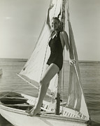 One Piece Swimsuit Prints - Young Woman Posing On Sailboat Print by George Marks