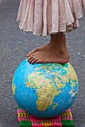 Foot Prints - Young woman standing on globe Print by Garry Gay