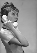 Young Adult Framed Prints - Young Woman Talking On Phone In Studio, (b&w) Framed Print by George Marks