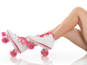 Roller Skates Photo Prints - Young Woman Wearing Roller Derby Skates Print by Oleksiy Maksymenko