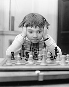 Chess Posters - Youngest Champ Poster by Douglas Miller