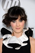 Hair Bun Photo Framed Prints - Zooey Deschanel At Arrivals For Our Framed Print by Everett