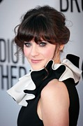 Hair Bun Photo Framed Prints - Zooey Deschanel  Wearing A Moschino Framed Print by Everett