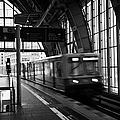 Berlin S-bahn Train Speeds Past Platform At Alexanderplatz Main Train Station Germany by Joe Fox