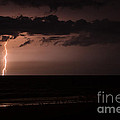 Lightning Over The Ocean by Dawna  Moore Photography