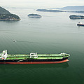 Tanker Ships At Anchor Offshore Of The by Andrew Buchanan/SLP