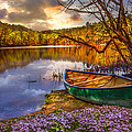 Canoe At The Lake by Debra and Dave Vanderlaan