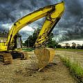 Yellow Excavator by Jaroslaw Grudzinski