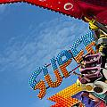 Colorful Fairground Ride Print by Ken Biggs