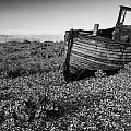 Stunning Black And White Image Of Abandoned Boat On Shingle Beac by Matthew Gibson