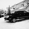 4x4 Pickup Trucks Parked In Driveway In Snow Covered Residential Street During Winter Saskatoon Sask by Joe Fox