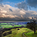 A storm over English countryside with dramatic cloud formations  Print by Matthew Gibson