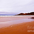 Agate Beach Oregon With Yaquina Head Lighthouse by Artist and Photographer Laura Wrede