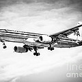 Amercian Airlines 757 Airplane In Black And White by Paul Velgos