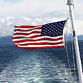 American Flag Blowing In The Wind At Sea by Jessica Foster