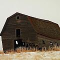 An Old Leaning Barn In North Dakota by Jeff Swan