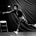 Arthur Ashe Returning Tennis Ball by Retro Images Archive