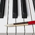 Artist Brush On Piano Keys by Garry Gay