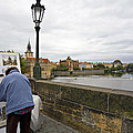 Artist On The Charles Bridge - Prague by Madeline Ellis