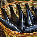Basket With Bottles by Carlos Caetano